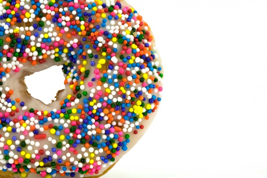 Luscious sprinkle donut close-up tempts us.